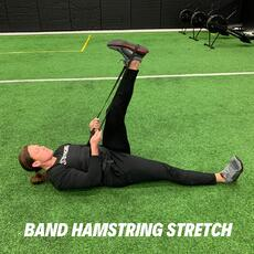 Orthopedic Institute athletic trainer demonstrates the band hamstring stretch to help relieve low back pain.