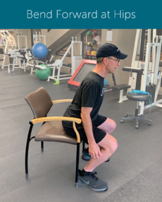 Orthopedic Institute physical therapist demonstrates how to correctly stand from a sitting position by bending forward at the hips before standing.