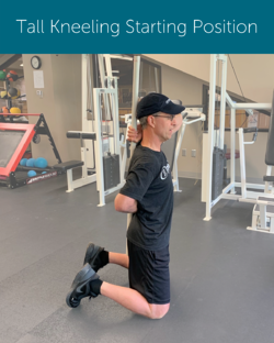 Orthopedic Institute physical therapist uses a long pole in a tall kneeling position to ensure a neutral spine when bending to avoid back pain.