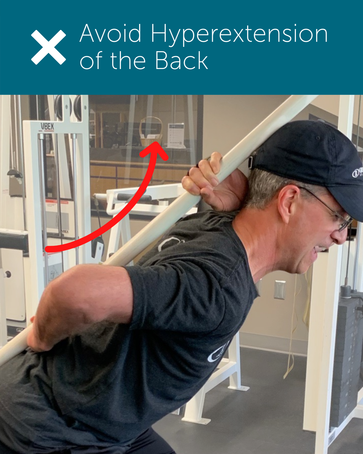 Orthopedic institute physical therapist demonstrates hyperextension of the back as an example of poor posture when squatting or hip hinging.